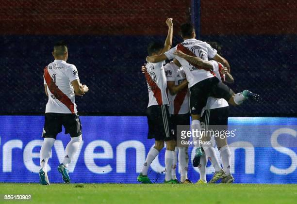 Ignacio Scocco of River Plate celebrates with teammates after scoring the first goal of his team during a match between Tigre and River Plate as part...