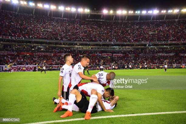 Ignacio Scocco of River Plate celebrates with teammates after scoring the first goal of his team during a first leg match between River Plate and...