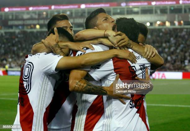 Ignacio Scocco of River Plate celebrates with teammates after scoring the first goal of his team during a second leg match between Lanus and River...