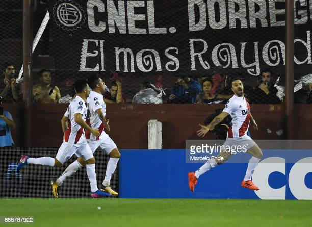 Ignacio Scocco of River Plate celebrates with teammates Enzo Perez and Gonzalo Martinez after scoring the first goal of his team during a second leg...
