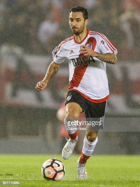 Ignacio Scocco of River Plate drives the ball during a second leg match between River Plate and Wilstermann as part of the quarter finals of Copa...