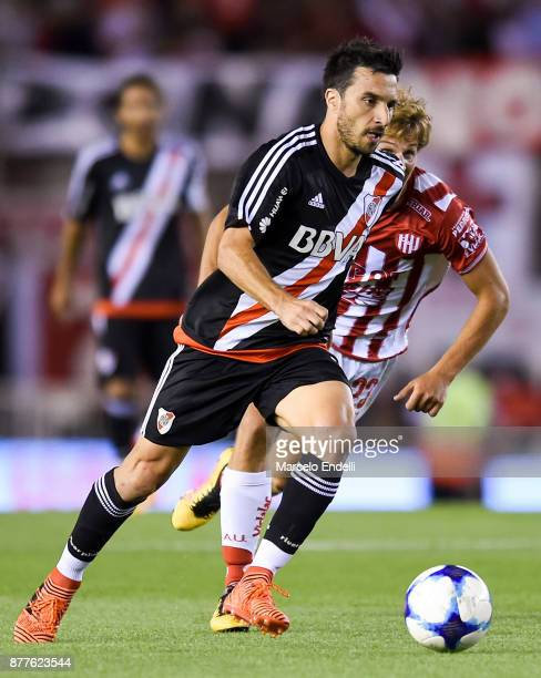 Ignacio Scocco of River Plate fights for ball with Manuel De Iriondo of Union during a match between River and Union as part of Superliga 2017/18 at...