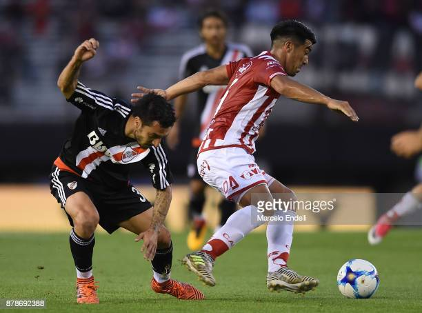 Ignacio Scocco of River Plate fights for ball with Nelson Acevedo of Union during a match between River and Union as part of Superliga 2017/18 at...