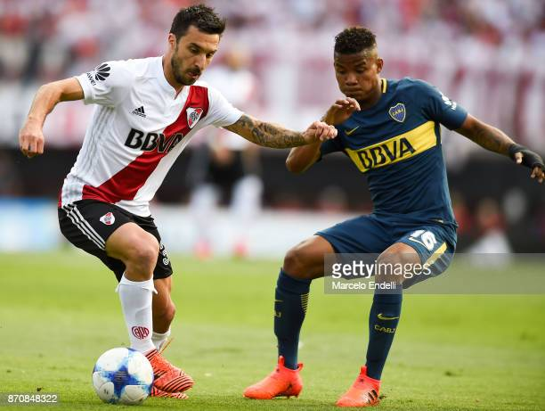 Ignacio Scocco of River Plate fights for ball with Wilmar Barrios of Boca Juniors during a match between River Plate and Boca Juniors as part of the...