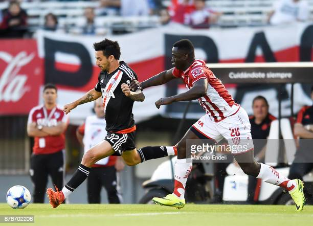 Ignacio Scocco of River Plate fights for ball with Yeimar Gomez of Union during a match between River and Union as part of Superliga 2017/18 at...