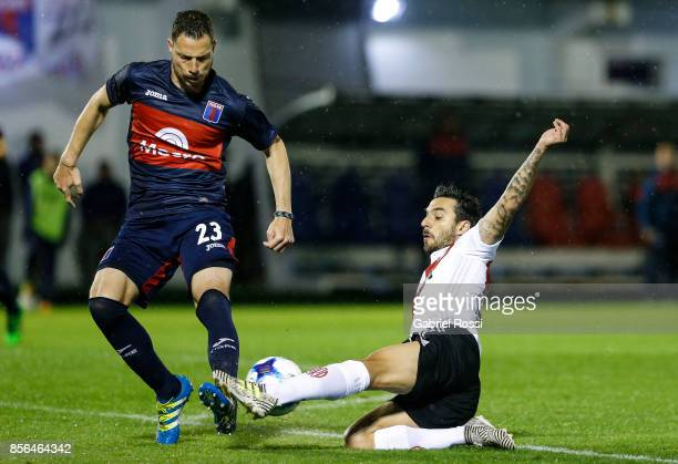 Ignacio Scocco of River Plate fights for the ball with Gaston Bojanich of Tigre during a match between Tigre and River Plate as part of Superliga...
