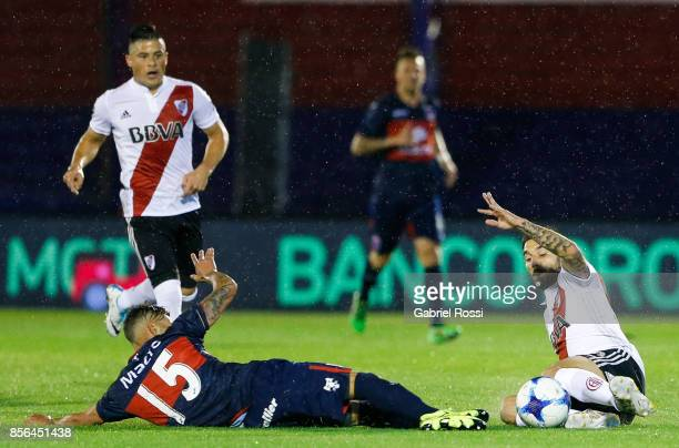 Ignacio Scocco of River Plate fights for the ball with Lucas Janson of Tigre during a match between Tigre and River Plate as part of Superliga...