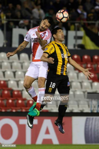 Ignacio Scocco of River Plate fights for the ball with Luis Cabral of Guarani during a first leg match between Guarani and River Plate as part of...