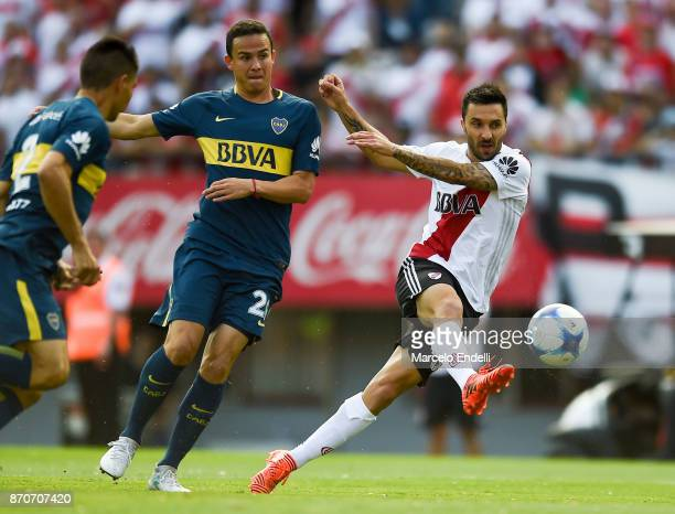 Ignacio Scocco of River Plate kicks the ball during a match between River Plate and Boca Juniors as part of the Superliga 2017/18 at Monumental...