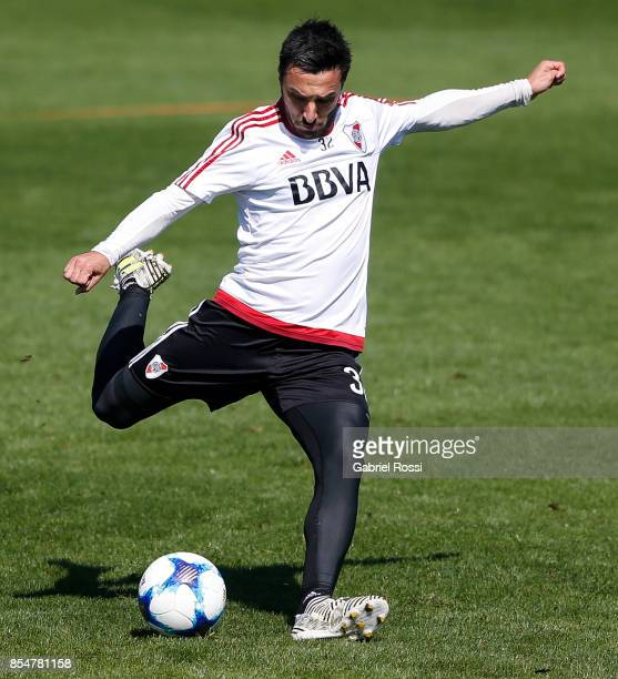 Ignacio Scocco of River Plate kicks the ball during a training session at River Plate's training camp on September 27 2017 in Ezeiza Argentina
