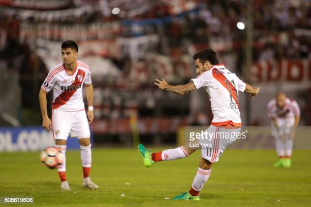 Ignacio Scocco of River Plate kicks the ball to score the opening goal of his team during a first leg match between Guarani and River Plate as part...