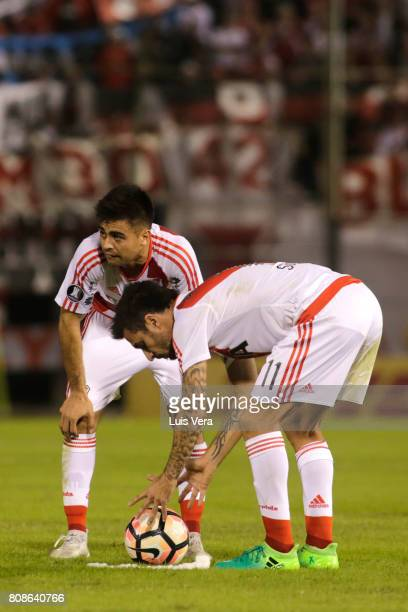 Ignacio Scocco of River Plate sets the ball on the grass during a first leg match between Guarani and River Plate as part of round of 16 of Copa...