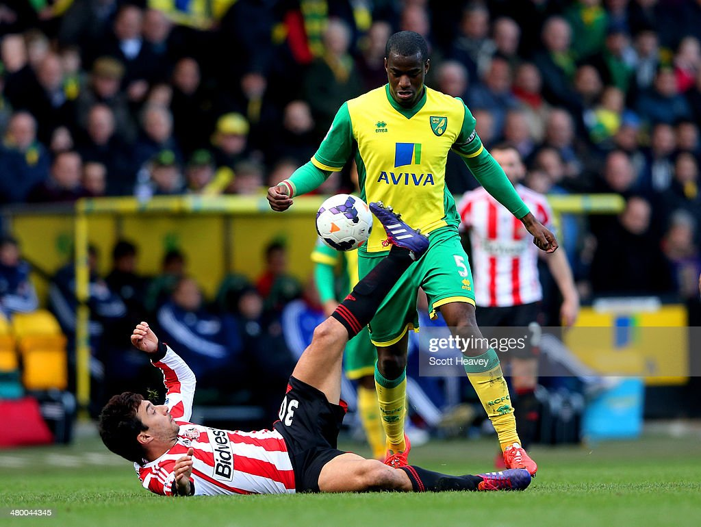 Ignacio Scocco of Sunderland and Sebastien Bassong of Norwich City compete for the ball during the Barclays Premier League match between Norwich City...