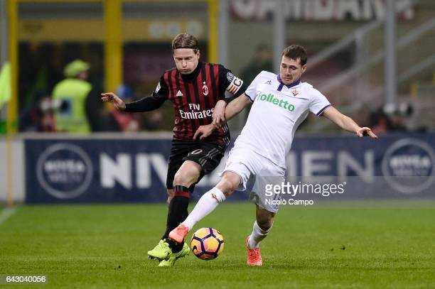 Ignazio Abate of AC Milan and Sebastian Cristoforo of ACF Fiorentina compete for the ball during the Serie A football match between AC Milan and ACF...