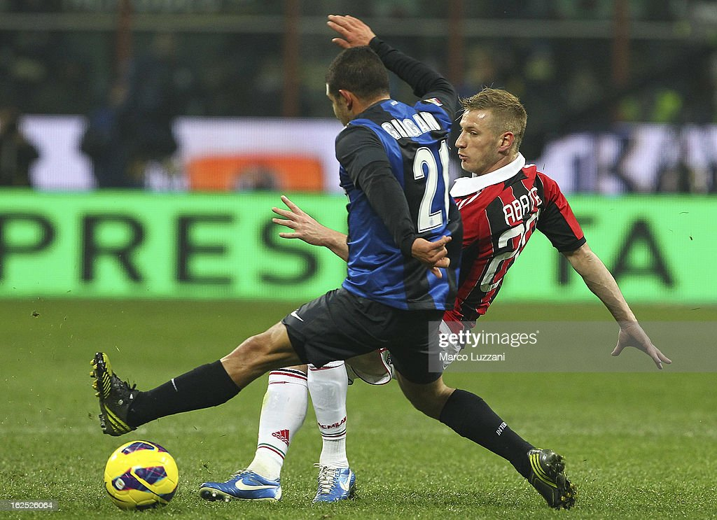 Ignazio Abate (R) of AC Milan competes for the ball with Guevara Walter Alejandro Gargano (L) of FC Internazionale Milano during the Serie A match FC Internazionale Milano and AC Milan at San Siro Stadium on February 24, 2013 in Milan, Italy.