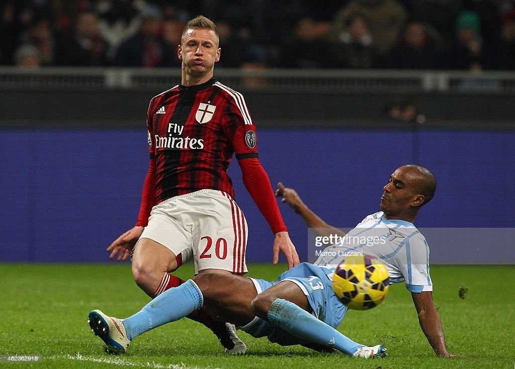 Ignazio Abate of AC Milan is challenged by Abdoulay Konko of SS Lazio during the TIM Cup match between AC Milan and SS Lazio at Stadio Giuseppe Meazza on January 27, 2015 in Milan, Italy.