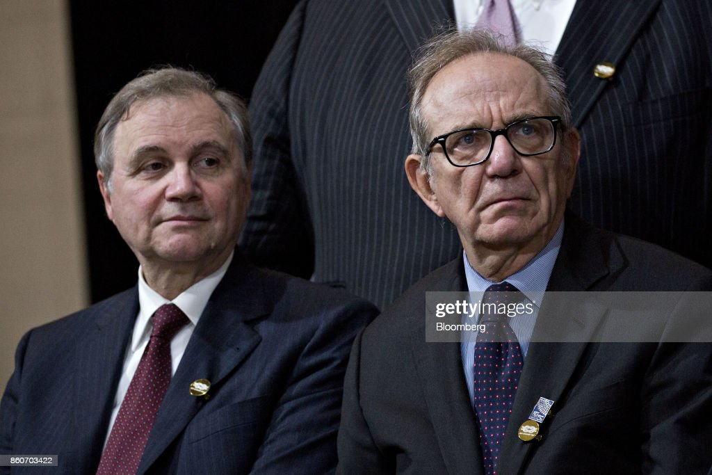 Ignazio Visco, governor of the Bank of Italy, left, and Pier Carlo Padoan, Italy's finance minister, sit during a Group of 20 (G-20) finance ministers and central bank governors group photo on the sidelines of the International Monetary Fund (IMF) and World Bank Group Annual Meetings in Washington, D.C., U.S., on Thursday, Oct. 12, 2017. Near-term risks to world financial stability have declined since April amid improving macroeconomic conditions and the subsiding risk of emerging-market turmoil, the IMF said in its latest Global Financial Stability Report released yesterday. Photographer: Andrew Harrer/Bloomberg via Getty Images
