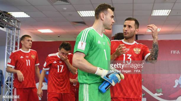 Igor Akinfeev and Fedor Kudriashov talk in the tunnel during the FIFA Confederations Cup Russia 2017 Group A match between Mexico and Russia at Kazan...