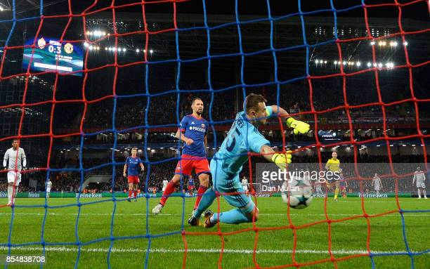 Igor Akinfeev of CSKA Moscow attempts to save as Henrikh Mkhitaryan of Manchester United scores his sides fourth goal during the UEFA Champions...