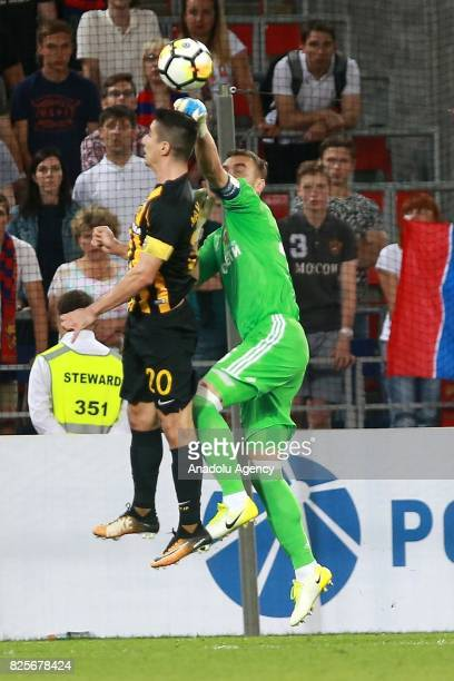 Igor Akinfeev of CSKA Moscow in action against Petros Mantalos of AEK Athens during the UEFA Champions League 3rd Qualifying Round match between CSKA...