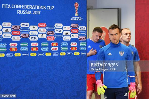 Igor Akinfeev of Russia leads the players for warm up prior to the FIFA Confederations Cup Russia 2017 Group A match between Mexico and Russia at...