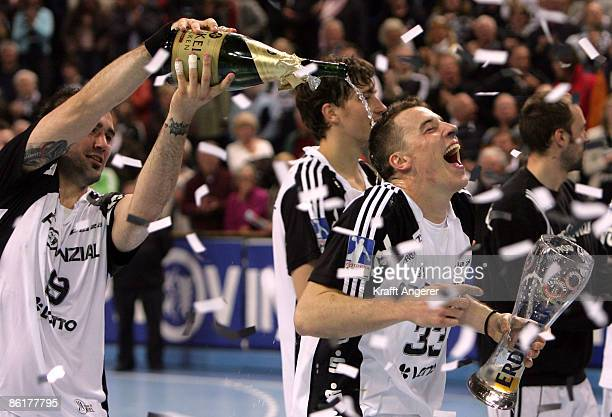 Igor Anic and Dominik Klein celebrate the win of the German championship after the Toyota Handball Bundesliga match between THW Kiel and HSG Wetzlar...
