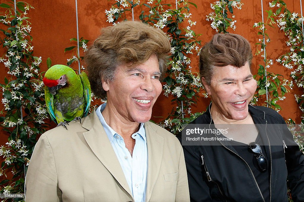 Igor Bogdanoff and his brother Grichka Bogdanoff pose with parrot Zoe during Day Seven of the 2016 French Tennis Open at Roland Garros on May 28, 2016 in Paris, France.