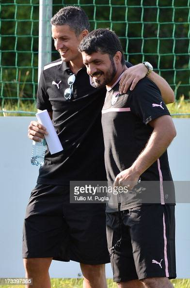Igor Budan hugs Coach Gennaro Gattuso during a US Citta di Palermo preseason training session at Sportzentrum on July 13 2013 in Sankt Lambrecht near...