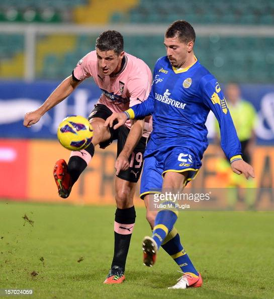 Igor Budan of Palermo and Fabrizio Cacciatore of Verona compete for the ball during the TIM Cup match between US Citta di Palermo and Hellas Verona...
