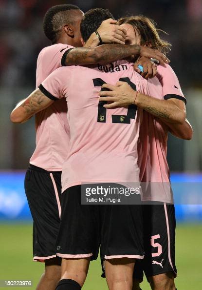 Igor Budan of Palermo celebrates with team mates after scoring his team's fourth goal during the preseason friendly match between US Citta di Palermo...