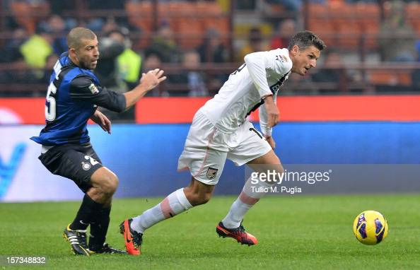 Igor Budan of Palermo holds off the challenge from Walter Samuel of Inter during the Serie A match between FC Internazionale Milano and US Citta di...