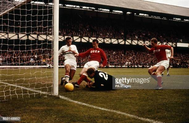 Igor Chislenko scoring USSR's first goal after Hungary's goalkeeper Jozef Gelei on ground fails to hold the ball