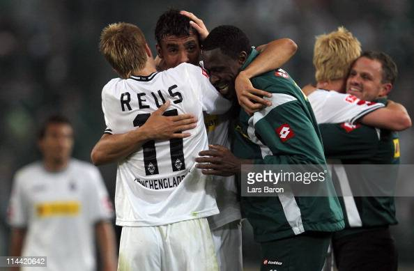 Igor de Camargo fo Moenchengladbach who scored the winning goal celebrates with Marco Reus and Mohamadou Idrissou after winning the Bundesliga play...