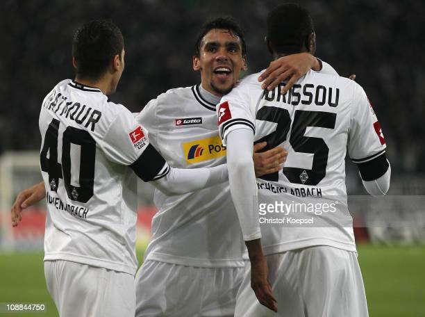 Igor de Camargo of Gladbach celebrates the first goal with Karim Matmour of Gladbach and Mohamadou Idrissou of Gladbach during the Bundesliga match...