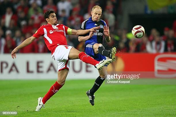 Igor De Camargo of Liege challenges David Jarolim of Hamburg during the UEFA Europa League quarter final second leg match between Standard Liege and...