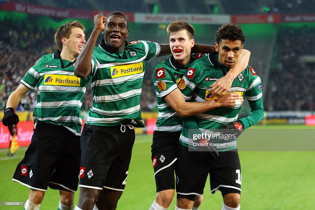 <a gi-track='captionPersonalityLinkClicked' href=/galleries/search?phrase=Igor+de+Camargo&family=editorial&specificpeople=2514599 ng-click='$event.stopPropagation()'>Igor de Camargo</a> of Moenchengladbach (R) celebrates the first goal with Patrick Herrmann (L), <a gi-track='captionPersonalityLinkClicked' href=/galleries/search?phrase=Peniel+Mlapa&family=editorial&specificpeople=5870921 ng-click='$event.stopPropagation()'>Peniel Mlapa</a> (2nd L) and Havard Nordtveit (2nd R) during the UEFA Europa League group C match between Borussia Moenchengladbach and AEL Limassol FC at Borussia Park Stadium on November 22, 2012 in Moenchengladbach, Germany.