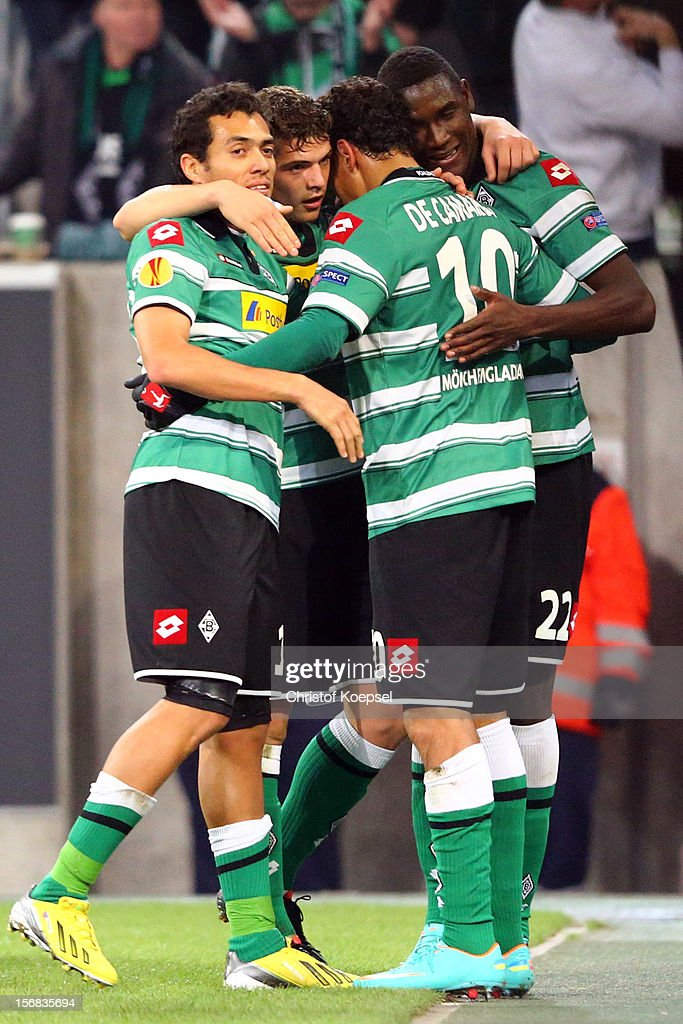 <a gi-track='captionPersonalityLinkClicked' href=/galleries/search?phrase=Igor+de+Camargo&family=editorial&specificpeople=2514599 ng-click='$event.stopPropagation()'>Igor de Camargo</a> of Moenchengladbach (2nd R) celebrates the second goal with Juan Arango (L), <a gi-track='captionPersonalityLinkClicked' href=/galleries/search?phrase=Granit+Xhaka&family=editorial&specificpeople=5848141 ng-click='$event.stopPropagation()'>Granit Xhaka</a> (2nd L) and <a gi-track='captionPersonalityLinkClicked' href=/galleries/search?phrase=Peniel+Mlapa&family=editorial&specificpeople=5870921 ng-click='$event.stopPropagation()'>Peniel Mlapa</a> (R) of Moenchengladbach during the UEFA Europa League group C match between Borussia Moenchengladbach and AEL Limassol FC at Borussia Park Stadium on November 22, 2012 in Moenchengladbach, Germany. The match between Moenchengladbach and Limassol ended 2-0.
