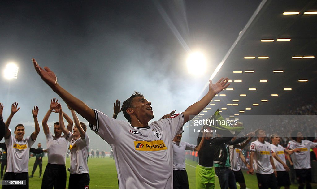 <a gi-track='captionPersonalityLinkClicked' href=/galleries/search?phrase=Igor+de+Camargo&family=editorial&specificpeople=2514599 ng-click='$event.stopPropagation()'>Igor de Camargo</a> of Moenchengladbach celebrates with team mates after the Bundesliga play off second leg match between VfL Bochum and Borussia Moenchengladbach at Rewirpower Stadium on May 25, 2011 in Bochum, Germany.