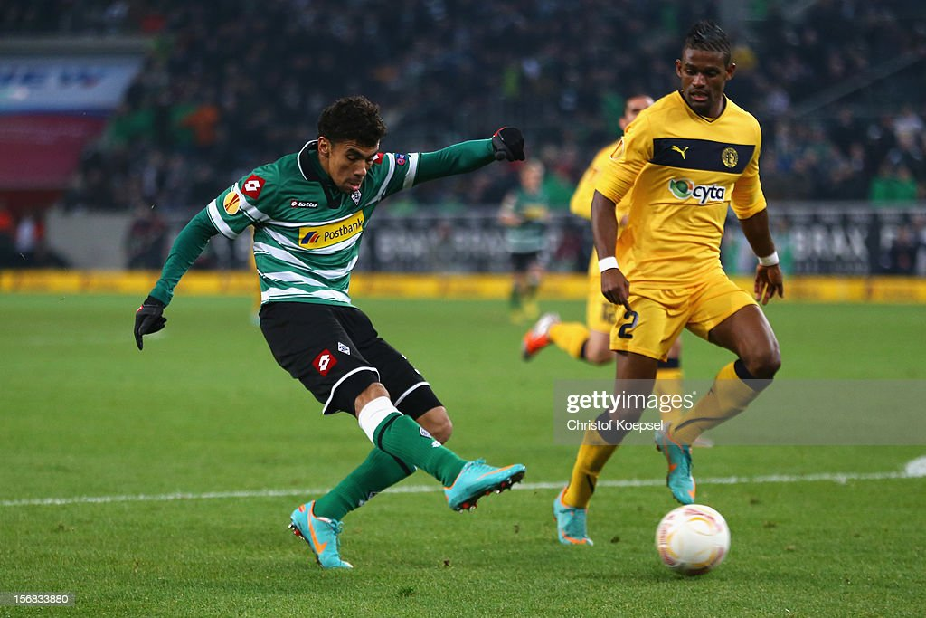 <a gi-track='captionPersonalityLinkClicked' href=/galleries/search?phrase=Igor+de+Camargo&family=editorial&specificpeople=2514599 ng-click='$event.stopPropagation()'>Igor de Camargo</a> of Moenchengladbach (L) scores the first goal against Dosa Junior of Limassol during the UEFA Europa League group C match between Borussia Moenchengladbach and AEL Limassol FC at Borussia Park Stadium on November 22, 2012 in Moenchengladbach, Germany.