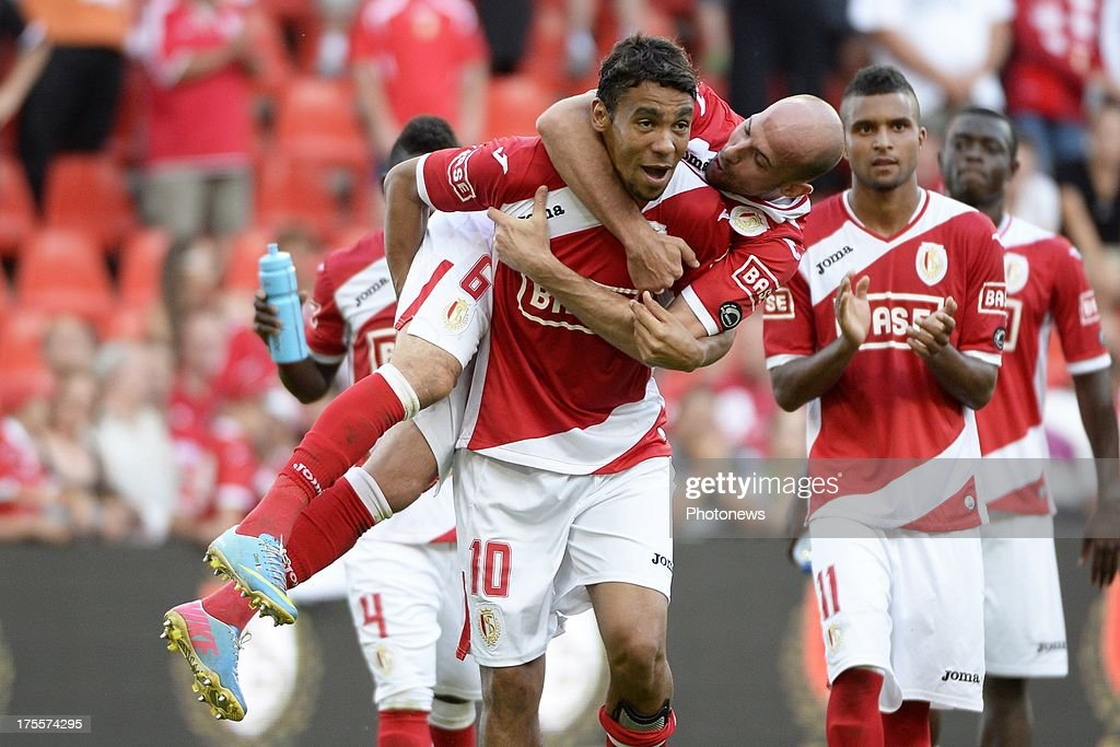 Igor De Camargo of Standard and Laurent Ciman of Standard celebrates pictured during the Jupiler League match between Standard Liege and SK Lierse on Augustus 4, 2013 in Liege, Belgium. (Photo by Vincent Kalut & Jimmy Bolcina / Photonews