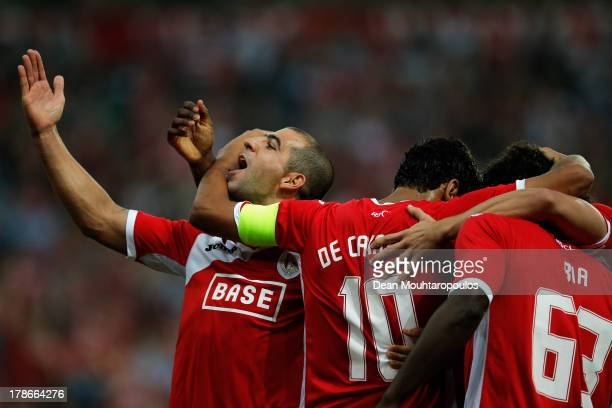 Igor De Camargo of Standard Liege celebrates scoring the second goal of the game with team mates during the Second Leg Play Off UEFA Europa League...