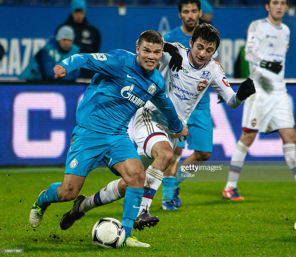 <a gi-track='captionPersonalityLinkClicked' href=/galleries/search?phrase=Igor+Denisov&family=editorial&specificpeople=648334 ng-click='$event.stopPropagation()'>Igor Denisov</a> of FC Zenit St. Petersburg (L) and <a gi-track='captionPersonalityLinkClicked' href=/galleries/search?phrase=Alan+Dzagoev&family=editorial&specificpeople=5436464 ng-click='$event.stopPropagation()'>Alan Dzagoev</a> of PFC CSKA Moscow vie for the ball during the Russian Football League Championship match between FC Zenit St. Petersburg and PFC CSKA Moscow at the Petrovsky Stadium on November 26, 2012 in St. Petersburg, Russia.
