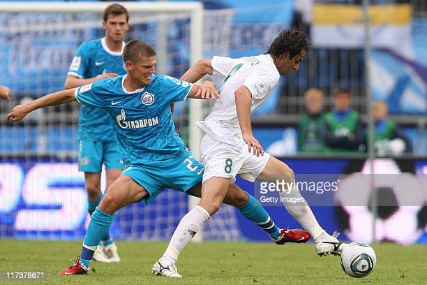 Igor Denisov of FC Zenit St Petersburg battles for the ball with Mauricio of FC Terek Grozny during the Russian Football League Championship match...