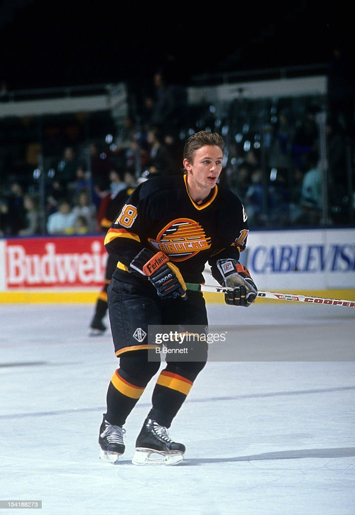 <a gi-track='captionPersonalityLinkClicked' href=/galleries/search?phrase=Igor+Larionov&family=editorial&specificpeople=201768 ng-click='$event.stopPropagation()'>Igor Larionov</a> #18 of the Vancouver Canucks warms-up before an NHL game against the New York Islanders circa 1990 at the Nassau Coliseum in Uniondale, New York.