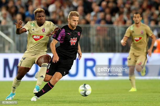 Igor Lewczuk of Bordeaux and Ezekiel Henty of Vdeoton in action during the UEFA Europa League qualifying match between Bordeaux and Videoton at Stade...