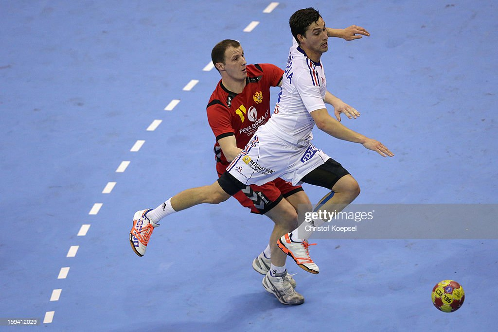 Igor Markovic of Montenegro defends against Samuel Honrubia of France during the premilary group A match between Montenegro and France at Palacio de Deportes de Granollers on January 13, 2013 in Granollers, Spain.