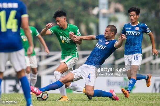 Igor Miovic of Rangers trips up with Chun Lok Tan of Wofoo Tai Po during the week three Premier League match between BC Rangers and Wofoo Tai Po at...