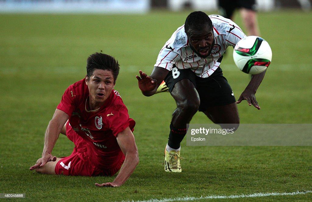 Igor Portnyagin (L) of FC Rubin Kazan is challenged by <a gi-track='captionPersonalityLinkClicked' href=/galleries/search?phrase=Fegor+Ogude&family=editorial&specificpeople=7917446 ng-click='$event.stopPropagation()'>Fegor Ogude</a> of FC Amkar Perm during the Russian Premier League match between FC Rubin Kazan and FC Amkar Perm at Tsentraliniy Stadium on July 26, 2015 in Kazan, Russia.