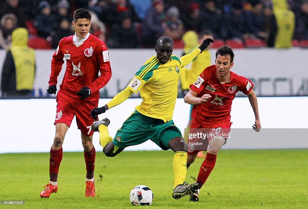 Igor Portnyagin (L), Vladimir Sobolev (R) of FC Rubin Kazan are challenged by <a gi-track='captionPersonalityLinkClicked' href=/galleries/search?phrase=Mohammed+Rabiu&family=editorial&specificpeople=6335728 ng-click='$event.stopPropagation()'>Mohammed Rabiu</a> (C) of FC Kuban Krasnodar during the Russian Premier League match between FC Rubin Kazan and FC Kuban Krasnodar at the Kazan Arena Stadium on March 5, 2016 in Kazan, Russia.