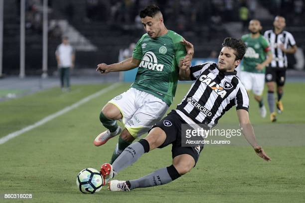Igor Rabello of Botafogo battles for the ball with Alan Ruschel of Chapecoense during the match between Botafogo and Chapecoense as part of...